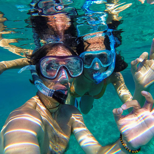 Couple Snorkeling In Cabo San Lucas
